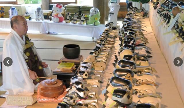 日本寺庙为100只机械狗办丧礼司仪是新款机器人