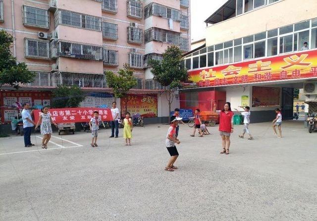 驻马店市第二十社区志愿者v社区塘坊小学开展四北方小学外国语图片